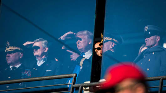 President-Elect Donald J. Trump watches from a box with with US Army personnel and staff during an Army/Navy football game in Baltimore, MD, on Saturday, Dec. 10, 2016.