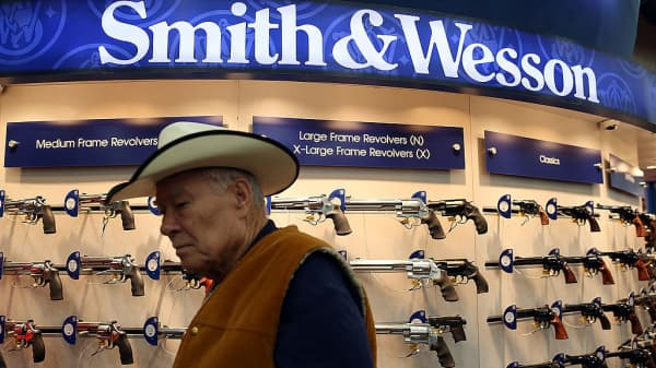 An attendee walks through the Smith & Wesson booth at the NRA's annual meeting.
