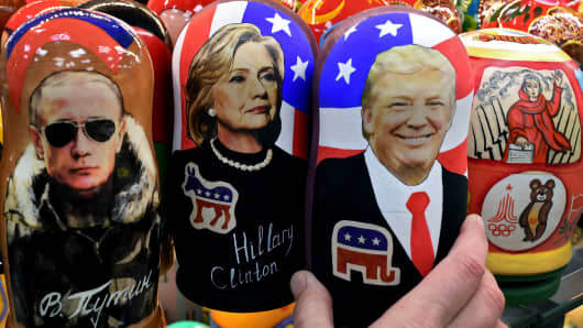 Traditional Russian matryoshka dolls depicting Vladimir Putin, Hillary Clinton and Donald Trump are seen on sale at a gift shop in central Moscow on November 8, 2016.