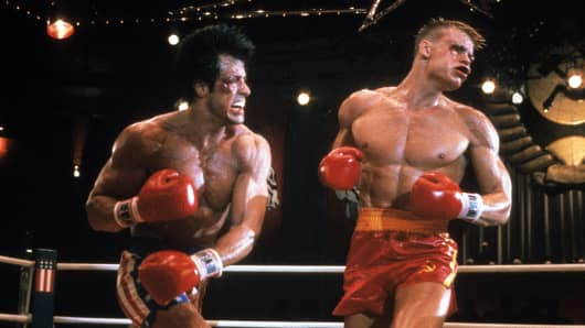 Sylvester Stallone punches Dolph Lundgren in a scene from the film 'Rocky IV', 1985.