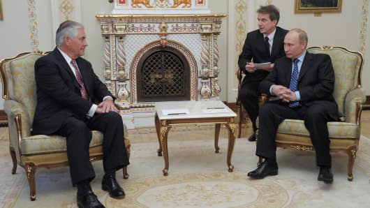 Then Russian Prime Minister Vladimir Putin and Exxon Mobil Chief Executive Rex Tillerson attend a meeting at the Novo-Ogaryovo state residence outside Moscow, Russia April 16, 2012.