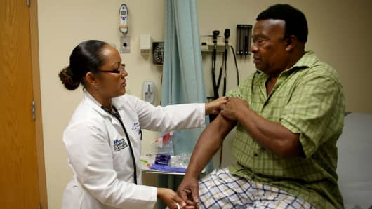 A newly insured patient under the Affordable Care Act receives a checkup at the South Broward Community Health Services clinic in Hollywood, Florida.