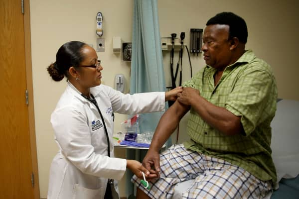 An insured patient under the Affordable Care Act receives a checkup at the South Broward Community Health Services clinic in Hollywood, Florida.