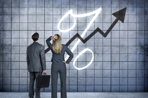 Businessman And Businesswoman Looking At Prospect Of Higher Interest Rates
