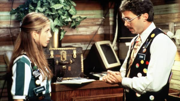 "Waitress Jennifer Aniston talks with her boss in a scene from ""Office Space."""
