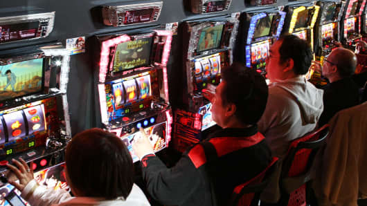 Players in a Pachinko room in Tokyo.