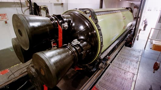 A Minuteman III missile engine is loaded into a truck for transport to another building for X-raying before being torn down and rebuilt, Thursday, June 22, 2000, at Hill Air Force Base, Utah.