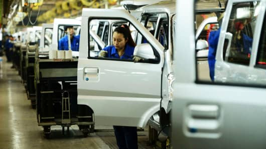 Laborers work in the Qingdao branch of SAIC-GM-Wuling Automobile in Qingdao, China.