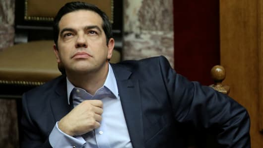 Greek Prime Minister Alexis Tsipras looks on during a parliamentary session before a budget vote in Athens, Greece, December 10, 2016.