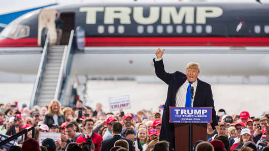 Donald Trump speaks at a campaign rally in front of his airplane, March 12, 2016 in Vandalia, Ohio.