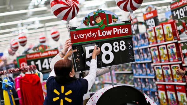 a walmart worker organizes products for christmas season at a walmart store in teterboro new