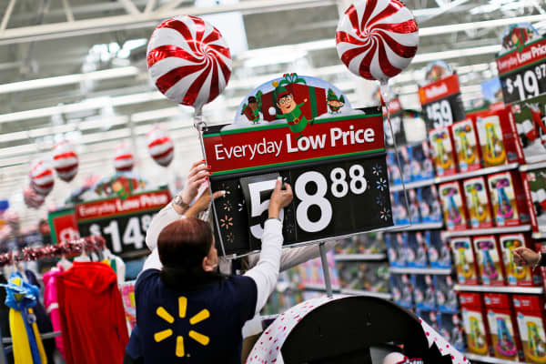 A Walmart worker organizes products for Christmas season at a Walmart store in Teterboro, New Jersey.