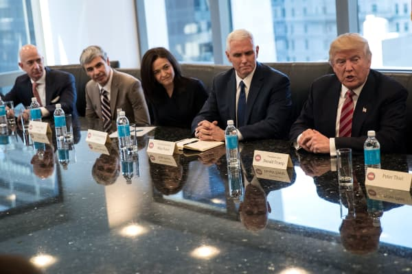 (L to R) Amazon CEO Jeff Bezos, Alphabet CEO Larry Page, Facebook COO Sheryl Sandberg, Vice President-elect Mike Pence, President-elect Donald Trump, during a meeting of technology executives at Trump Tower, Dec. 14, 2016 in New York.