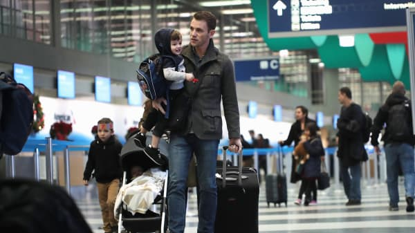 Passengers arrive for their flights at O'Hare International Airport in Chicago.