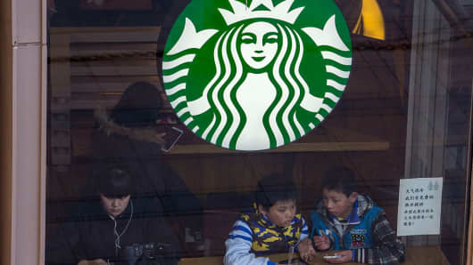 People sit in a Starbucks outlet in China on February 22, 2016.
