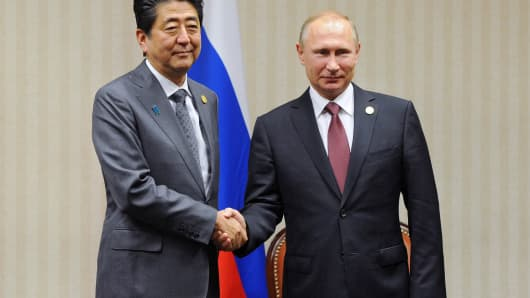November 19, 2016: Russian President Vladimir Putin and Japanese Prime Minister Shinzo Abe at a meeting on the sidelines of the Asia-Pacific Economic Cooperation (APEC) Leaders' Meeting in Lima.