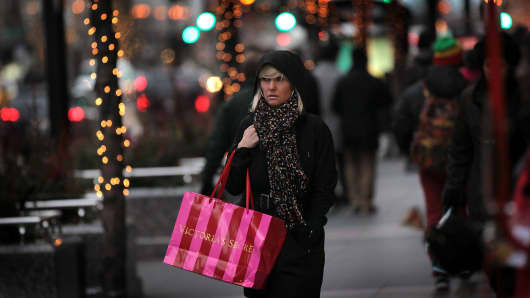 A shopper carries her purchases along the Magnificent Mile shopping district in Chicago, Illinois.