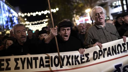 Pensioners take part in an anti-austerity demonstration in central Athens on December 15, 2016.