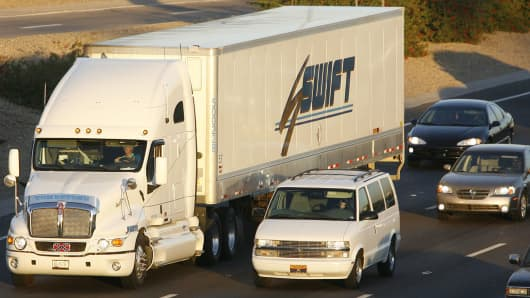 A Swift truck is driven down the I-10 highway, just west of downtown Phoenix