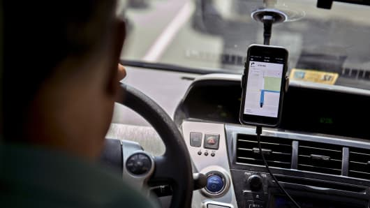 The Uber Technologies application on a smartphone during an Uber ride in Washington, D.C.