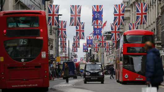 Union flags are attached between buildings along Oxford street in central London on June 27, 2016.