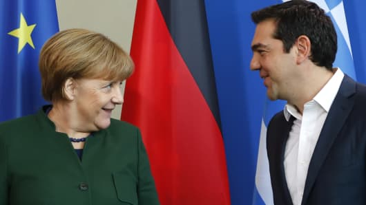 German Chancellor Angela Merkel and Greek Prime Minister Alexis Tsipras leave after a statement at the chancellery in Berlin on Dec. 16, 2016.