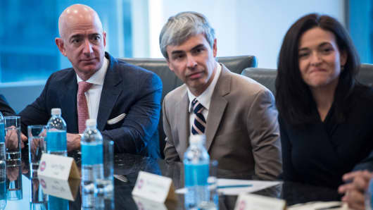 From left Amazon founder Jeff Bezos, Alphabet CEO Larry Page, and Facebook COO Sheryl Sandberg listen during a meeting with technology industry leaders at Trump Tower in New York, NY on Wednesday, Dec. 14, 2016.