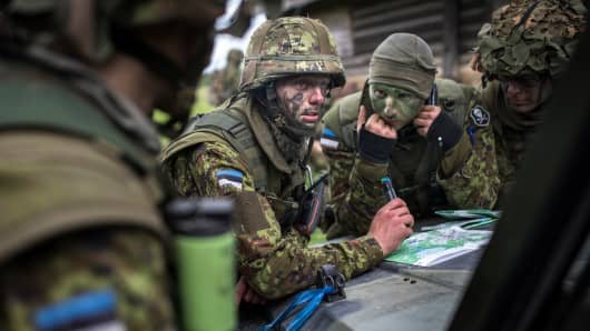 Estonian Special Forces soldiers seen reading a map after raiding the woods during a NATO troop exercise in Estonia.