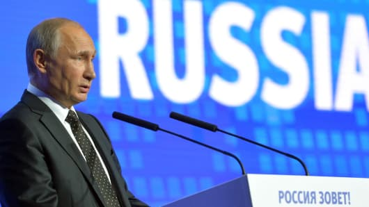 Russian President Vladimir Putin gives a speech at the 8th annual VTB Capital 'Russia Calling!' Investment Forum in Moscow on October 12, 2016.