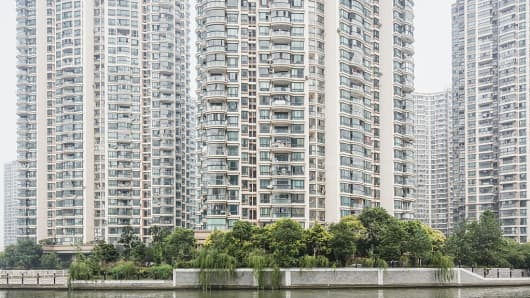 Apartment buildings in Shanghai, China. Government curbing measures are beginning to make an impact on home prices in China.