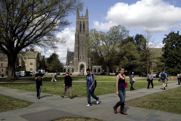People walk by Duke Chapel on the campus of Duke University in Durham, North Carolina, U.S.