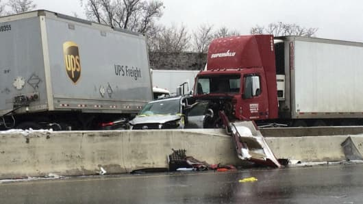 Wrecked vehicles lie next to the divider after a series of accidents on Interstate 95 in Baltimore, Md., on Saturday morning, Dec. 17, 2016, following an overnight ice storm.