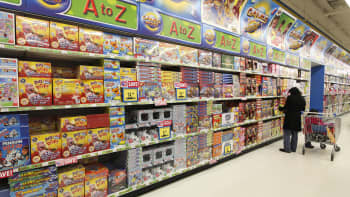 A customer browses the board games section inside a Toys 'R' Us Inc. store.