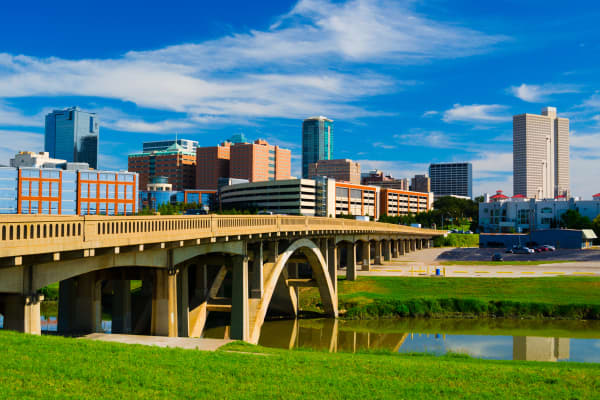 Downtown Fort Worth skyline with the Trinity River and Bridge in the foreground. Fort Worth is a part of the Dallas-Fort Worth Metropolitan Area.