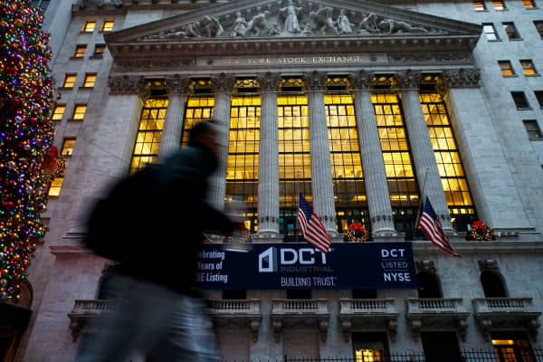 A pedestrian passes the New York Stock Exchange.