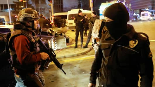Turkish police secure the area near an art gallery where the Russian Ambassador to Turkey Andrei Karlov was shot in Ankara, Turkey, December 19, 2016.