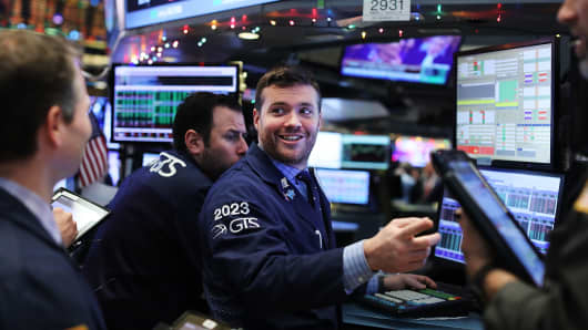 Traders work on the floor of the New York Stock Exchange in New York City.