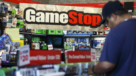 Signage is displayed as a customer browses at a GameStop Corp. store in West Hollywood, California.