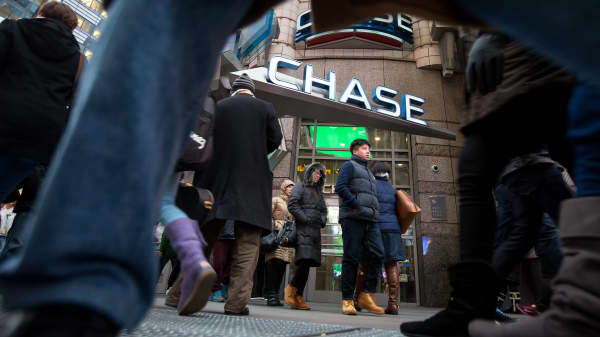 Pedestrians pass a JPMorgan Chase bank branch in New York.
