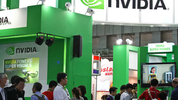 Visitors walk past the NVIDIA Corp. booth at the Computex Taipei 2011 in Taipei, Taiwan.
