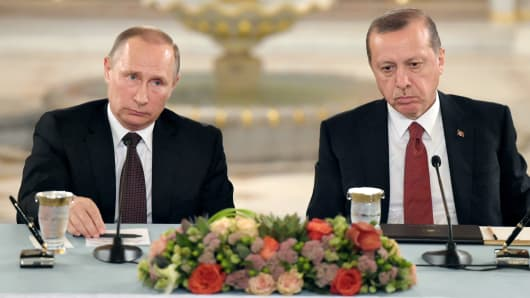 Russian President Vladimir Putin (left) and President of Turkey Recep Tayyip Erdogan (right) attend 23rd World Energy Congress in Istanbul on October 10, 2016 in Istanbul, Turkey.