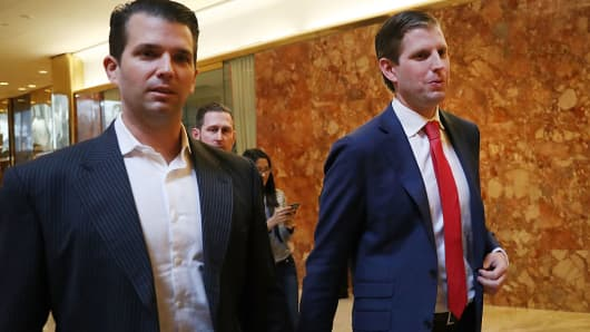 Donald Trump's sons Donald Trump Jr., (L), and Eric Trump, walk in Trump Tower on November 14, 2016 in New York City.