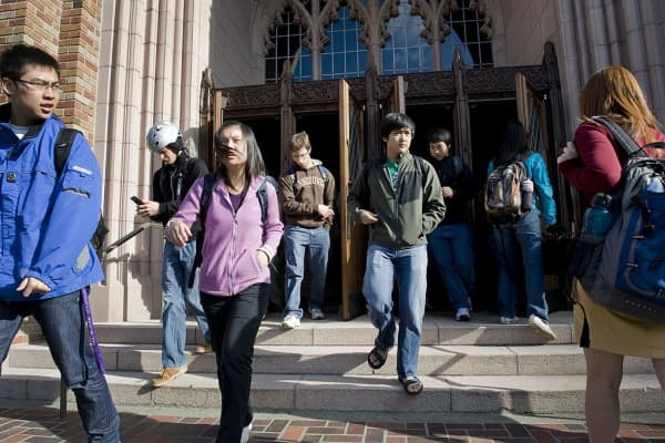 Students study and walk between classes on the college campus of the University of Washington in Seattle, WA.