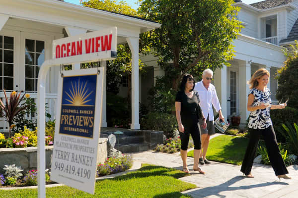 A couple are shown a property for sale in Newport Beach, California.