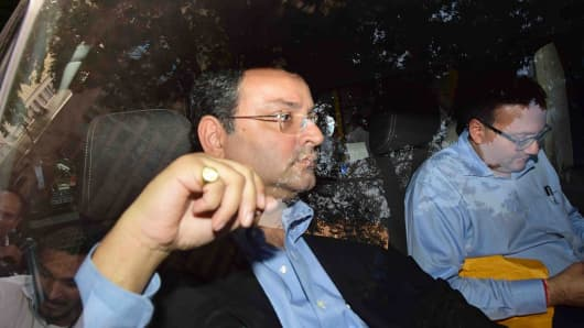 Cyrus Mistry (L), former Chairman of Tata Sons, leaves from Bombay House, the headquarters of the Tata Group, on October 26, 2016 in Mumbai, India.