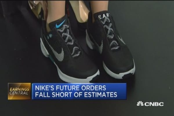 Nike beats Street but races to keep on top