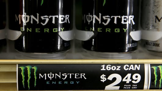 Cans of Monster Energy Drink are displayed on a shelf at a convenience store on August 14, 2014 in Kentfield, California.