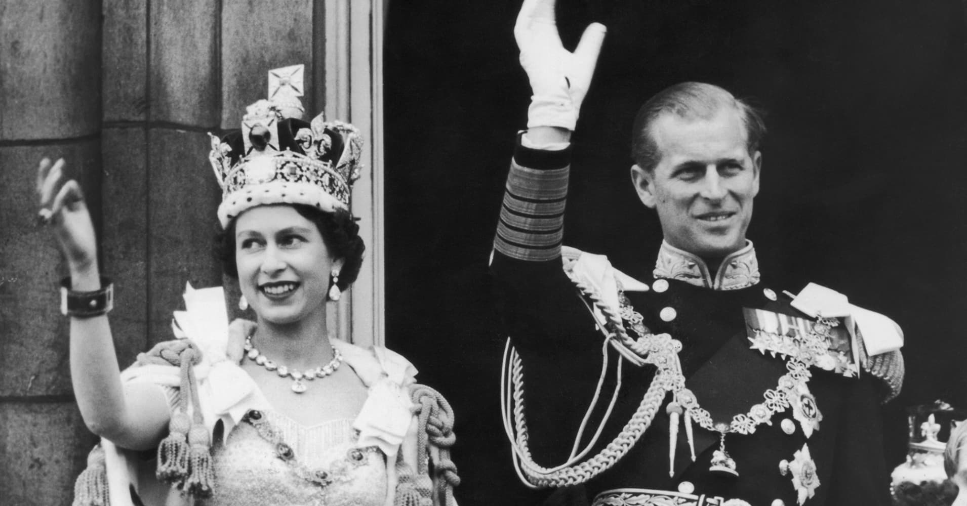 Queen Elizabeth II and the Duke of Edinburgh wave from the balcony at Buckingham Palace during the queen's coronation celebrations June 2, 1953.