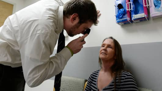 A neurologist checks a patient during an exam at the St. Vincent Hospital in Leadville, Colorado.