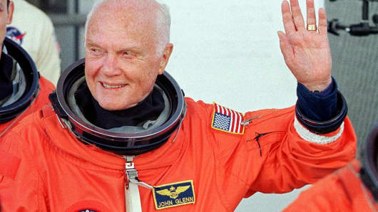 US astronaut and senator John Glenn waves as he leaves the Operations and Check out building at the Kennedy Space Center, FL, 29 October in route to board the US space shuttle Discovery.